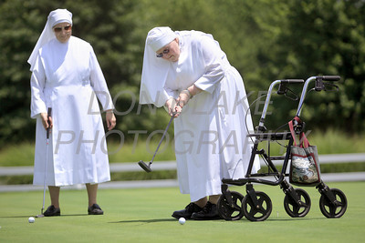Mother Joseph Caroline, LSP tries her hand at putting as Sr. Therese, LSP watches during the Little Sisters of the Poor 4th Annual Swing Fore Sisters Golf Outing at Cavaliers Country Club, Newark, Del., Thursday, June 30, 2011. The Dialog/Don Blake