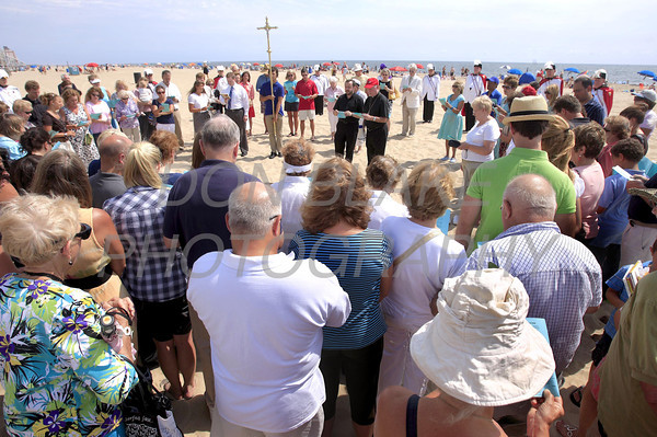 The faithful gather with Bishop Malooly on the beach for the annual blessing of the ocean in Ocean City, Maryland, Sunday, August 14, 2011. The Dialog/Don Blake
