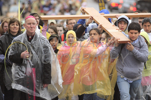 Bishop Malooly walks with teens as they carry the replica of the World Youth Day Cross on the third leg from St. Paul to St. Elizabeth Churches after adoration during the CYM Cross Pilgrimage in Wilmington, Del., Saturday, April 16, 2011. The Dialog/Don Blake