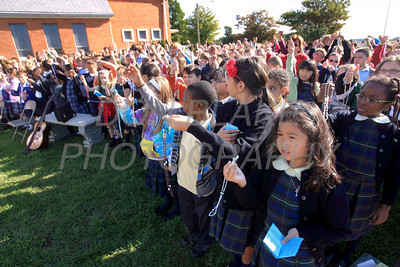 Catholic school students from around the Diocese hold up the rosary as Bishop bless them as they gather for the Rosary Rally at the Our Lady Queen of Peace statue on the grounds of Holy Spirit Church in New Castle, Del., Friday, October 7, 2011. photo/Don Blake Photography