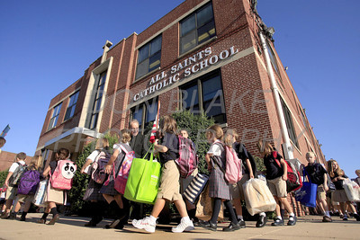 Students enter school during the first day of school at All Saints Catholic School, Elsmere, Del., Tuesday, August 30, 2011. The Dialog/Don Blake
