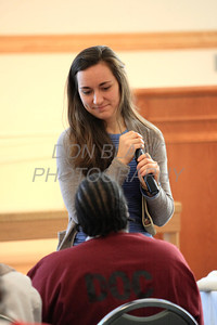 Dorothy DiMarino a Franciscan Ministry volunteer talks with one of the inmates before Bishop Malooly celebrates mass at the Baylor Women's Correctional Institution, New Castle, Del., Monday December 19, 2011. photo/Don Blake Photography.com
