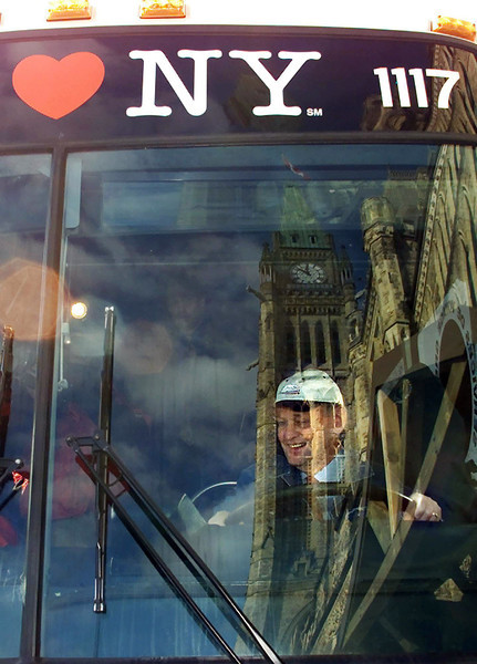 Prime Minister Jean Chretien sits behind the wheel of a bus participating in a Canada Loves New York campaign on Parlaiment Hill, Wednesday, November 21, 2001. (CP PHOTO/Fred Chartrand)