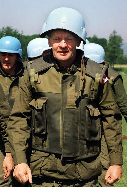 Prime Minister Jean Chretien wearing fatiques and U.N. army helmet backwards tours a Canadian U.N. camp in Visoko, Bosnia Thursday, June 9, 1994. Prime Minister Chretien announced Wednesday, Aug. 21, 2002 he intends to step down in February 2004. (CP PICTURE ARCHIVE/Fred Chartrand)