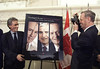 Prime Minister Jean Chretien tries his hand at photography as he photographs his official photographer Jean-Marc Carisse during a book launch of Carisse's photographs entitled Privileged Access with Trudeau, Turner and Chretien, on Parliament Hill, Wednesday, May 3, 2000.(CP PHOTO/Fred Chartrand)