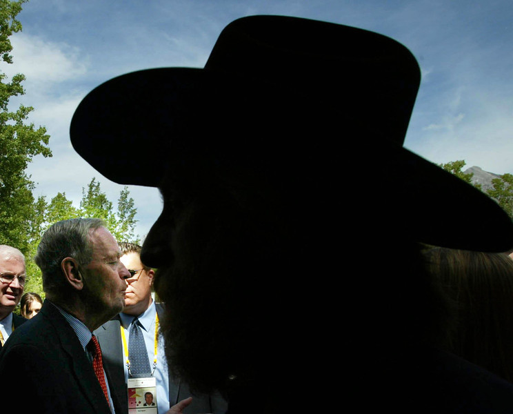 Prime Minister Jean Chretien holds an impromptu news conference at Boundary Ranch Tuesday, June 25, 2002 between arrivals of heads of state for the G8 meeting in Kananaskis, Alberta. (CP PHOTO/Fred Chartrand)