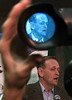 Prime Minister Jean Chretien  is shown through the eyepiece of a television camera  as he holds a news scrum while on an election campaign stop in Montreal, Sunday, November 5, 2000. Chretien  and the other party leaders will take part in televised debates this week.(CP PHOTO/Fred Chartrand.