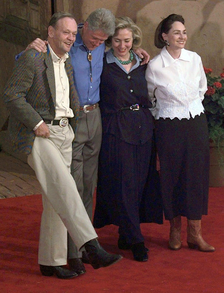 HOWDY--Canadian Prime Minister Jean Chretien lifts his leg to display a pair of cowboy boots he is wearing for an informal evening dinner hosted by U.S. President Bill Clinton in Denver, Colorado, the site if the Summit of Eight, Saturday June 21, 1997. With Chretien is U.S. President Bill Clinton and his wife Hillary Rodham Clinton and Chretien's wife Aline. Fred Chartrand/The Canadian Press
