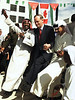 Prime Minister Jean Chretien joins in a Arabic dance with Palestinian refugees while visiting the Souf Palestinian Refugee Camp in Jerash, Jordan, Sunday,April 16, 2000.(CP PHOTO/Fred Chartrand)