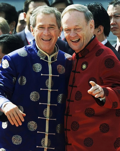 President George W. Bush and Canadian Prime Minister Jean Chretien smile for the cameras during an APEC Leaders Summit family photograph in Shanghai, China, Sunday Oct. 21, 2001.  Prime Minister Chretien announced Wednesday, Aug. 21, 2002 he intends to step down in February 2004. (CP PICTURE ARCHIVE/Fred Chartrand)