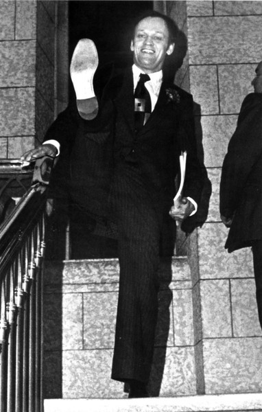 This is an April 10, 1978, photo of then Finance Minister Jean Chretien kicking up his heels and baring the sole of one of his new pair of shoes as he left the Parliament Building in Ottawa after presenting his budget. (CP PICTURE ARCHIVE/Fred Chartrand)
