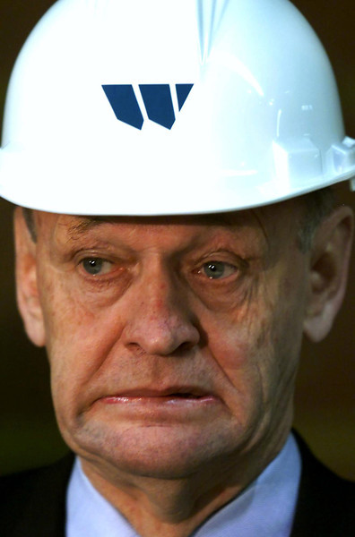 Prime Minister Jean Chretien, wearing a hard hat, reacts to the work being done on a woodworking machine at a wood plant in Scoudouc, New Brunswick, during a campaign stop Friday October 27, 2000.(CP PHOTO/Fred Chartrand)