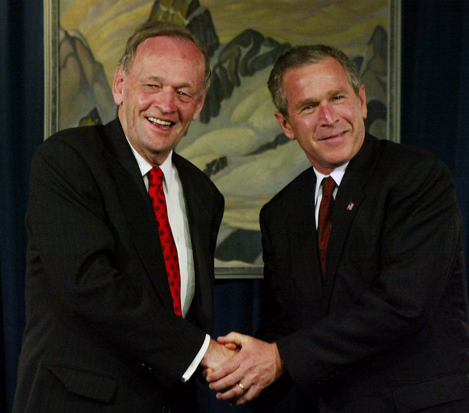 U.S. President George W. Bush and Prime Minister Jean Chretien shake hands Tuesday, June 25, 2002 during a meeting at the G8 Summit in Kananaskis, Alberta. (CP PHOTO/Fred Chartrand)
