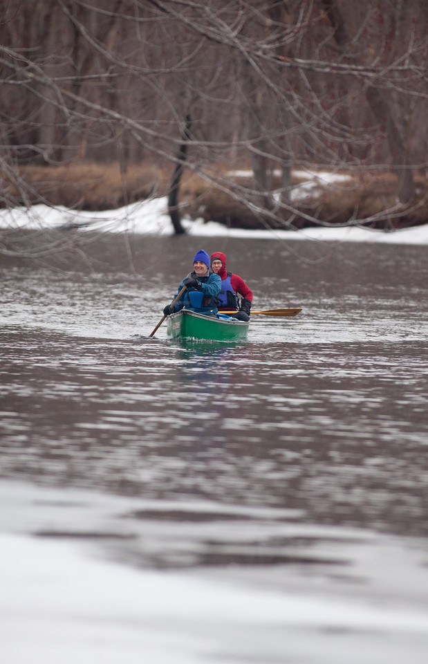 """3/28/15 Concord, New Hampshire -- Author Jay Atkinson (front of boat), 57, and his paddling partner Chris Pierce, 41 navigate the Merrimack River near Concord, New Hampshire March 28, 2015.  Their route retraces the 1697 escape of Hannah Dunston, a subject Atkinson writes about in his new book, """"Massacre on the Merrimack."""" Erik Jacobs for the New York Times"""