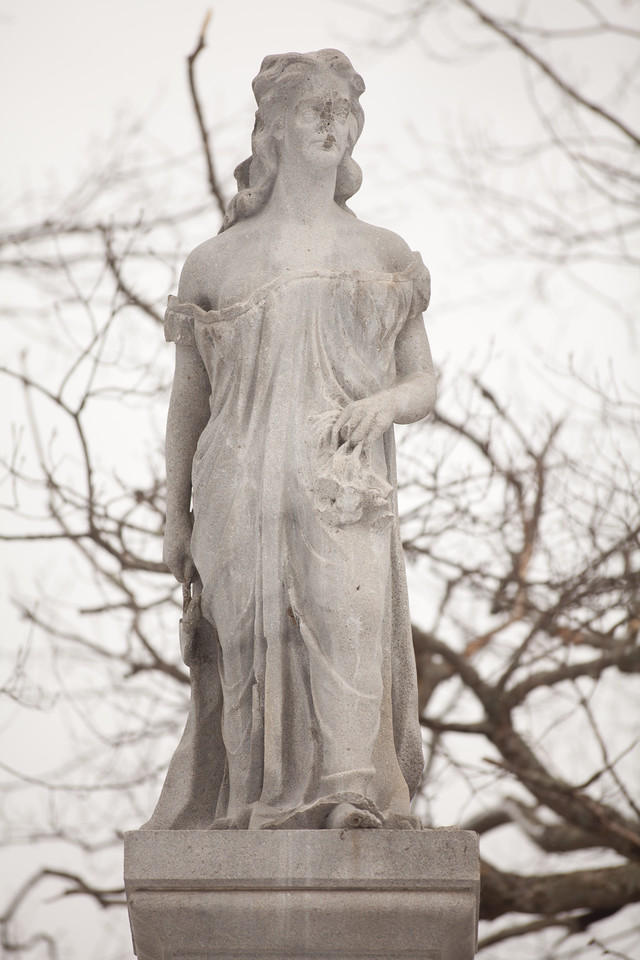 3/28/15 Concord, New Hampshire -- A statue of Hannah Dunston stands on the island where she was held captive and eventually escaped after killing her captives.  In her right hand is a hatchett and in her left is what appears to be scalps. Erik Jacobs for the New York Times