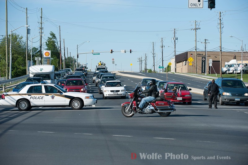 Traffic backed up as the police blocked the intersection for the riders.
