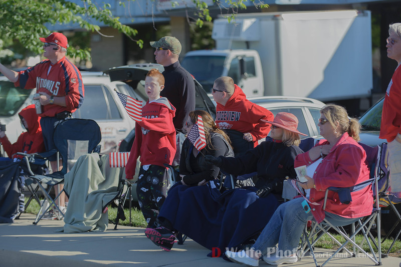 People lines the sidewalks to watch the prcoession of the roders who staged at the Gaithersberg Rolling Thunder  start location.