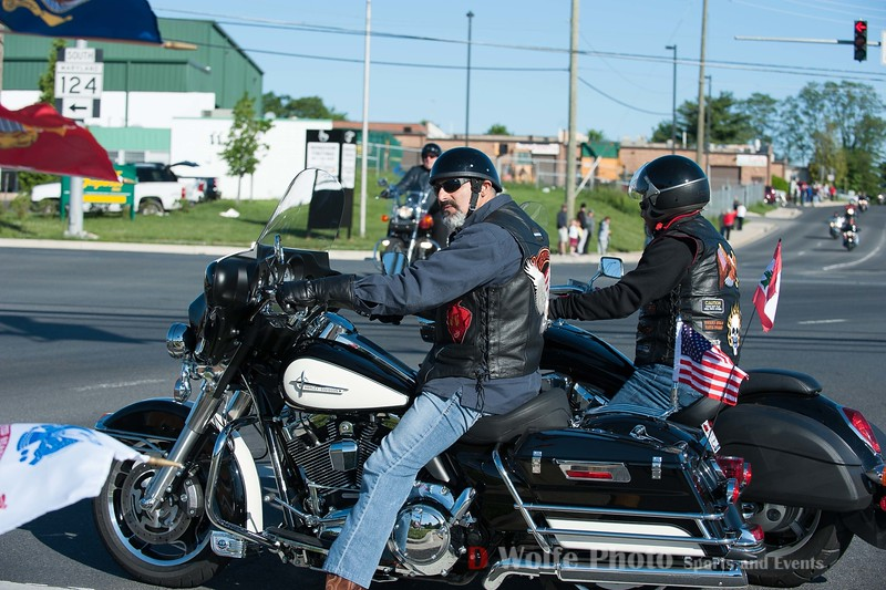 Two riders waiting their chance to join the convoy of riders.