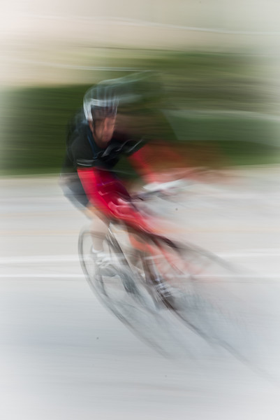 A biker is a blur of motion heading for the finish line Sunday in the Bartlett Kickstand Classic.