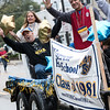 The Warren Township High School class of 198 shows it still has lots of pep as it winds down the parade route Saturday at the school's homecoming<1560>.