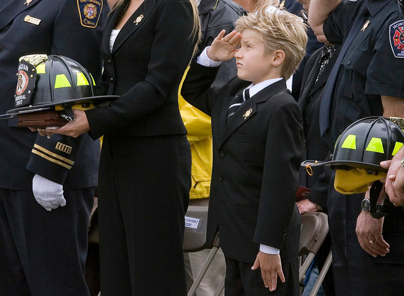 Eight-year-old Trent Johnston, the son of fallen Ottawa firefighter Mark Johnston, salutes during the Canadian Fallen Firefighters memorial ceremony on Parliament Hill in Ottawa Sunday, Sept. 9, 2007. (CP PHOTO/Fred Chartrand) CANADA
