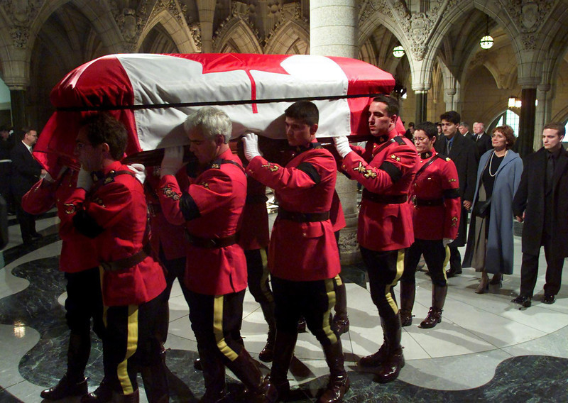 RCMP pallbearers carry the casket of former prime minster Pierre Trudeau into the Parliamentary Hall of Honour in Ottawa Saturday, September 30, 2000 followed by his sons Justin (left) and  Alexandre (Sacha) (right ) and his former wife Margaret.  Trudeau will lie in state untill Monday before being moved to Montreal for a state funeral.  (CP PHOTO/Fred Chartrand)