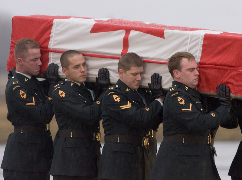 Pallbearers carry the coffin of Trooper Patrick Pentland,  one of two soldiers killed in Afghanistan last Wednesday, at CFB Trenton, Sunday, Apr.15, 2007. The bodies of two Canadian soldiers killed in Afghanistan have returned home following this country's bloodiest week of battle since the Korean War. (CP PHOTO/Fred Chartrand)
