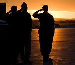 Military personnel are shilouetted against the setting sun during a repatriation ceremony for Corporal Andrew Grenon, Corporal Michael Seggie and Private Chad Horn in Trenton, Ontario, Satur ...