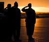 Military personnel are shilouetted against the setting sun during a repatriation ceremony for Corporal Andrew Grenon, Corporal Michael Seggie and Private Chad Horn in Trenton, Ontario, Saturday, September 6, 2008. The three soldiers were killed after an insurgent attack on their armoured vehicle while on patrol in Afghanistan, Wednesday.  <br />    Fred Chartrand/The Canadian Press