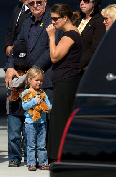 Diana Dawn Kaczmar, the widow of Sgt. Scott Shipway,  looks on as her four-year-old daughter Rowan clutches a teddy bear and her six-year-old brother Hayden is comforted by a relative by the hearse containing Sgt. Shipway's casket  during a repatriation ceremony at CFB Trenton in  Trenton, Ont.,  Wednesday, September 10 2008. Sgt. Shipway was killed after his armoured vehicle struck an improvised explosive device during a security patrol in Panjwayi District, September 7, 2008.