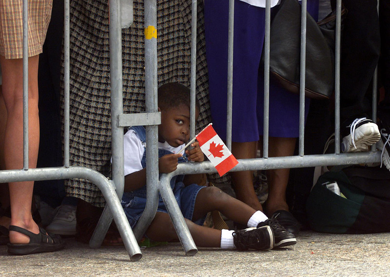 Vacationing in Ottawa with his family, two-and-a-half-year-old Jason Codling, of New York, N.Y., has a toddler's view of the Canada Day ceremonies on Parliament Hill in Ottawa, Thursday, July 1, 1999. (CP PHOTO/Fred Chartrand)