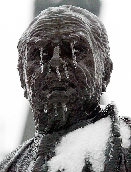 The statue of former Prime Minister John Diefenbaker is coated with ice on Parliament Hill in Ottawa Thursday, December 23, 2004. With fluctuating temperatures Ottawa and area have been getting snow, rain and freezing rain. (CP PHOTO/ Fred Chartrand)