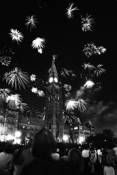 Parliament Hill is lit by Canada Day fireworks as crowds celebrate Canada's birthday in Ottawa on July 1, 1975.  (CP PHOTO/Fred Chartrand)