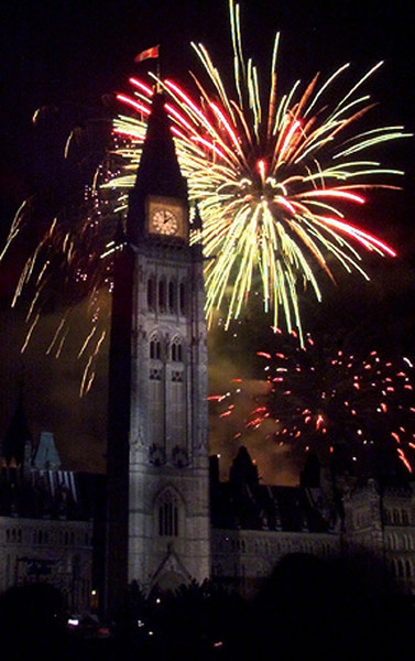 Fireworks burst over the Peace Tower on Parliament Hill to bring in the new millenniun and the year 2000 in Ottawa, Saturday, January 1, 2000.(CP PHOTO/Fred Chartrand)