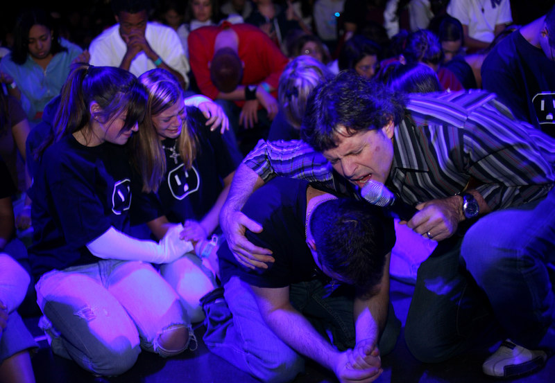 Amherst, MA 9/22/06.  Ron Luce prays with teenagers who came forward during an alter call at Acquire the Fire, a evangelical Christian event aimed at bringing teenagers back into the religious fold.  The two day event was held at the Mullins Center in Amherst, MA September 22nd and 23rd, 2006.<br /> Photo by Erik Jacobs for the New York Times