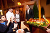 3/15/11 Somerville, MA -- Advance for Food.  General Manager Edson Coimbra, Jr presents the pig to guests March 15, 2011.  At far left, taking photos, is Antonio Cerqueira of Cambridge.  Erik Jacobs for the Boston Globe