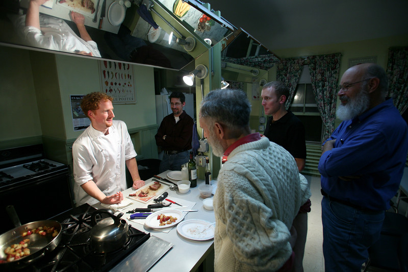 Cambridge, MA 11/16/06 --  From right, George Huff, Joe Hasenbush (white sweater) Chris Hart (black shirt) and Seth Silverman look on at bachelor cooking class taught by Chef Andrew Urbanetti (pictured) at The Cambridge Center for Adult Education in Harvard Square Thursday November 16, 2006. Photography by Erik Jacobs for the Boston Globe