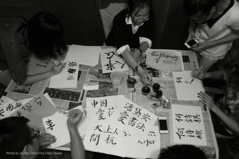 UI students practice calligraphy at the Asian Pacific American Cultural Center in Iowa City, Iowa on Monday, October 22, 2012. The event, Explore Asian Cultures: China, was put on by the Asian American Coalition. (The Daily Iowan/Sumei Chen)