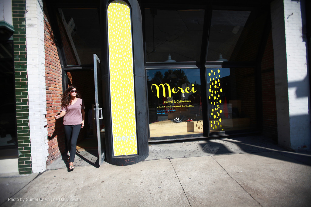 Merci staffer Rachel Laton walks out of the Merci in Iowa City, Iowa on Wednesday, September 26, 2012. Merci is a consignment store that reopens this month. (The Daily Iowan/Sumei Chen)