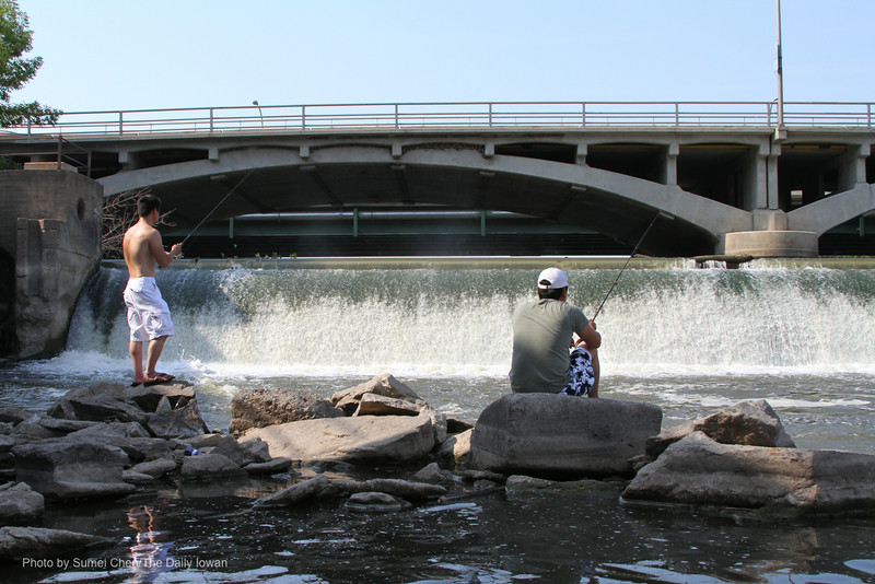 Iowa City, Iowa- Yi Wei Zheng (right) and Jimmy Le fish near the Burlington Street Dam on Sunday, July 1, 2012. The Burlington Street Dam may be turned into a recreation facility in the coming years. (The Daily Iowan/Sumei Chen)
