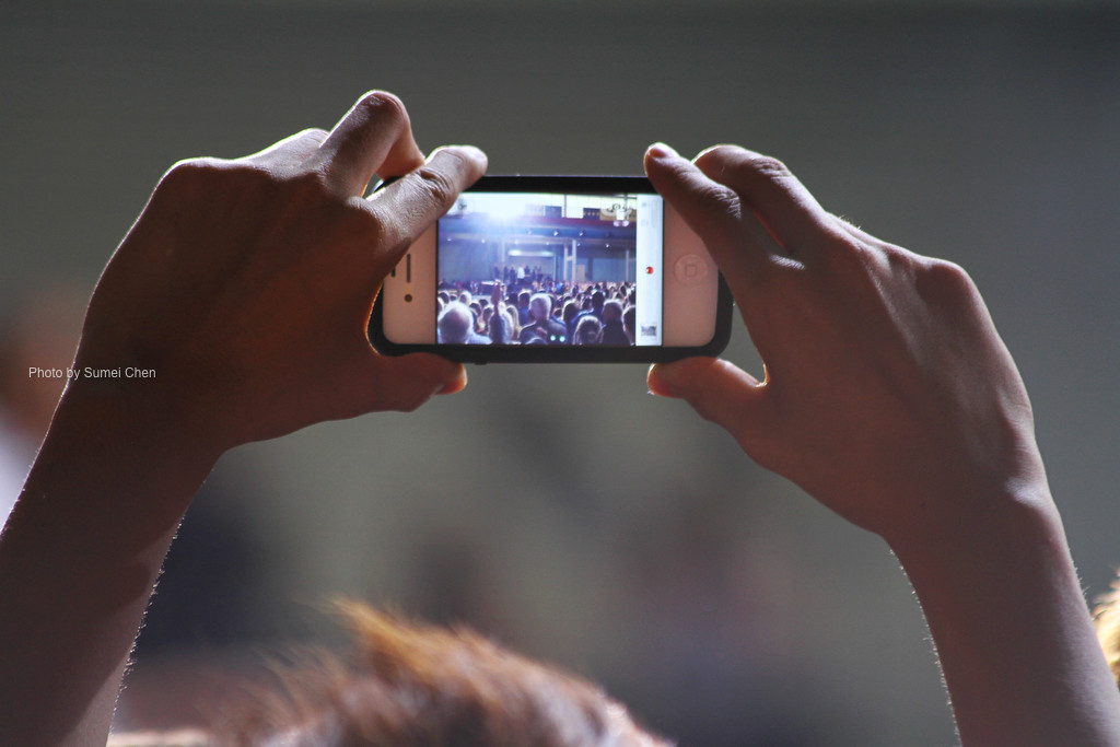 Iowa City, IA- A participant take a video when President Obama speaks on student debt at the Field House on April 25, 2012. (Photo by Sumei Chen)