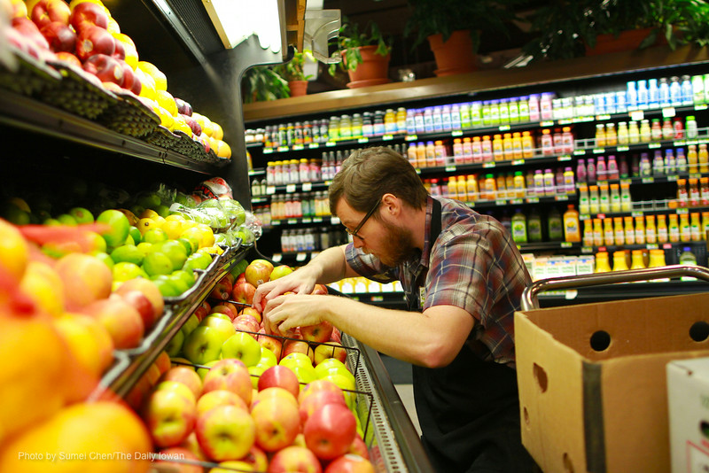 Douglas Nye stocks shelves at New Pioneer Food Co-op in Iowa City, IA on Thursday, September 13, 2012. (The Daily Iowan/Sumei Chen)