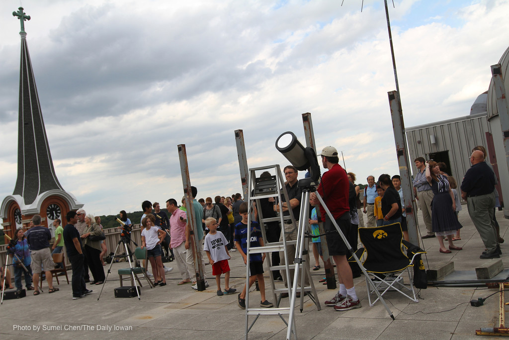 Iowa City, IA -People gather on the roof of the Van Allen Hall at UI to watch the transit of Venus on Tuesday, June 5, 2012. Special solar telescopes were set up. This is the last chance to see the transit of Venus until 2117. (The Daily Iowan/Sumei Chen)