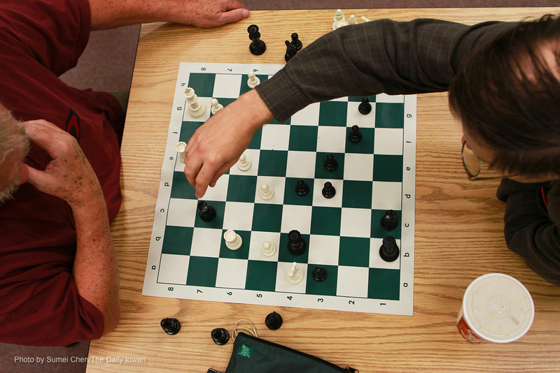 Chuck Miller (left) and Mark Craiglow play chess in Room 211 at Johnson County Senior Center in Iowa City, Iowa on Wednesday, September 19, 2012. The Gray Knights Chess Club meets 6:30-8:30 p.m. on Wednesdays. (The Daily Iowan/Sumei Chen)
