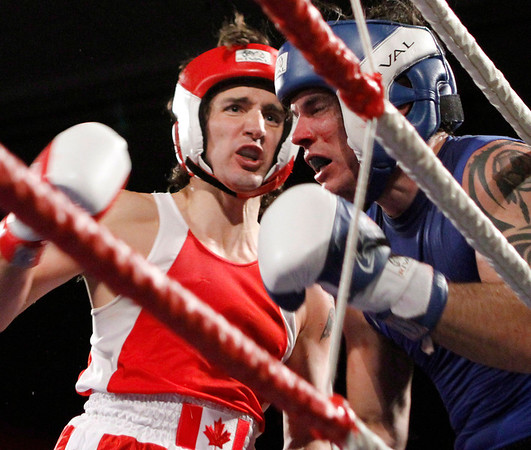 Liberal MP Justin Trudeau, left, fights Conservative Senator Patrick Brazeau during charity boxing match for cancer research Saturday, March 31, 2012 in Ottawa . THE CANADIAN PRESS/Fred Chartrand