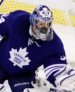 Toronto Maple Leafs goaltender James Reimer keeps his eyes on the puck during second  period NHL hockey action against the Ottawa Senators in Ottawa, Saturday February 4, 2012.THE CANADIAN PRESS/Fred Chartrand