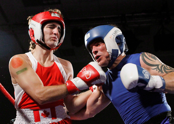 Conservative Senator Patrick Brazeau, right, and Liberal MP Justin Trudeau take part in a charity boxing match for cancer research Saturday, March 31, 2012 in Ottawa . THE CANADIAN PRESS/Fred Chartrand