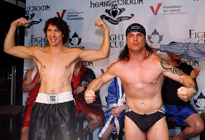 Conservative Senator Patrick Brazeau, right, and Liberal MP Justin Trudeau take part in a weigh-in for a upcoming boxing match Wednesday March 28, 2012, in Ottawa. The pair will meet this Saturday night where they will to go three rounds in a charity boxing match for cancer research. THE CANADIAN PRESS/Fred Chartrand