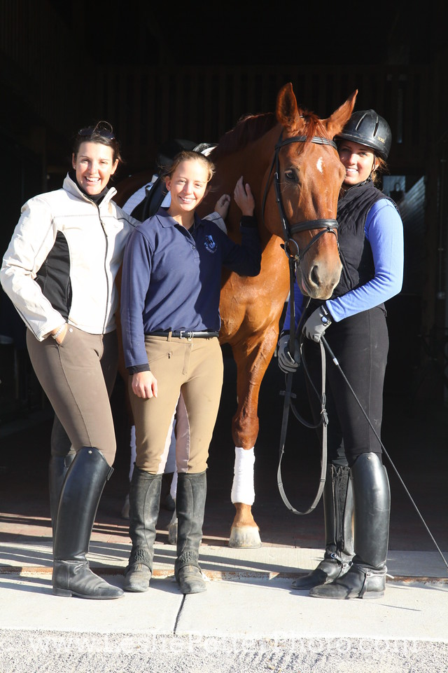 Dressage Trainer with Horse and Students