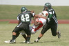 Bellaire quarterback #18 Adrian Nelson gets sacked by Austin #42 Sam Carrizal and #54 Abel Garcia.